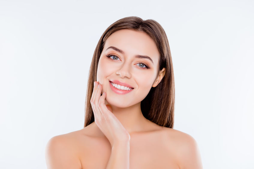 Clean clear pampering wellness freshness rejuvenation concept. Close up portrait of beautiful tender cute pure girl touching her smooth soft flawless perfect skin on cheek isolated on white background